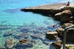 Лагуна на для любителей рыбного пилинга. Пляж Агиос Томас.